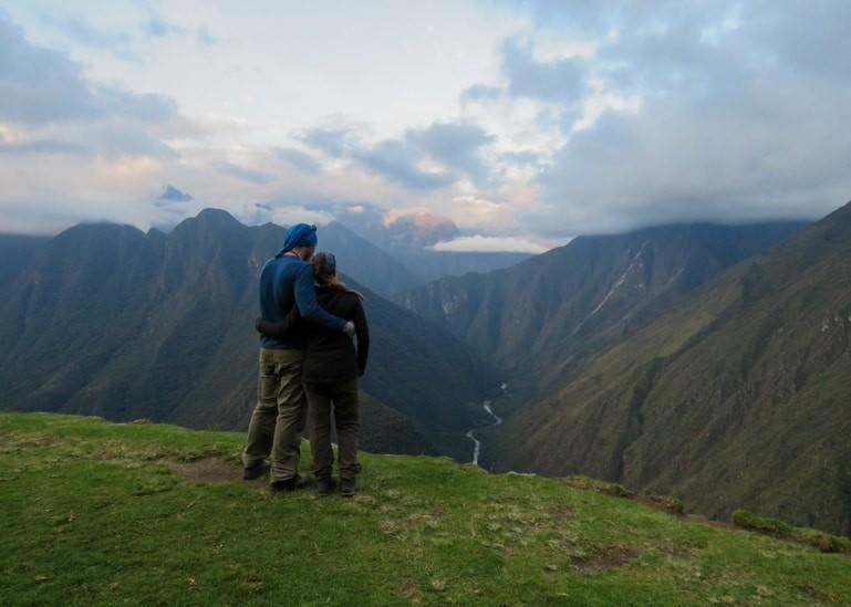 Couple overlook scenery along Inca Trail, Peru.