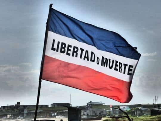 A Flag With Libertad o Muerte Written On