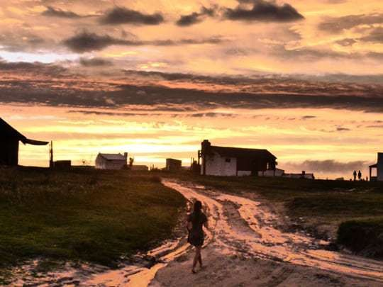 A Girl Walks In Cabo Polonio, Far Away From Civilization, At Sunset