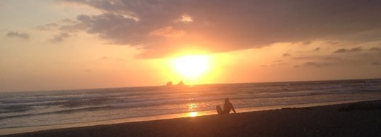 A Traveler Sits on the Beach During Sunset in Ayempe, Ecuador