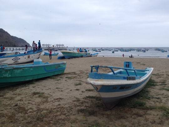 Boats on the sand at Puerto Lopez