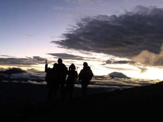 The Silouette of a Mountain Climbing Group at the Summit of Cotopaxi, Ecuador