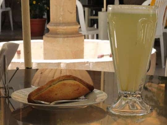 A Saltena and a juice for a quick morning pick-me-up.