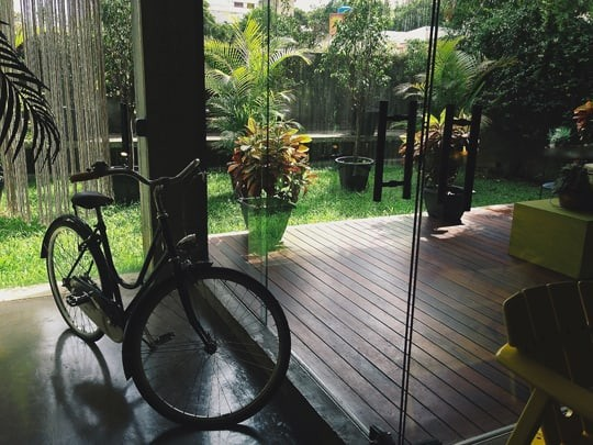A Bike Parked Outside The Door at Coffee Lab