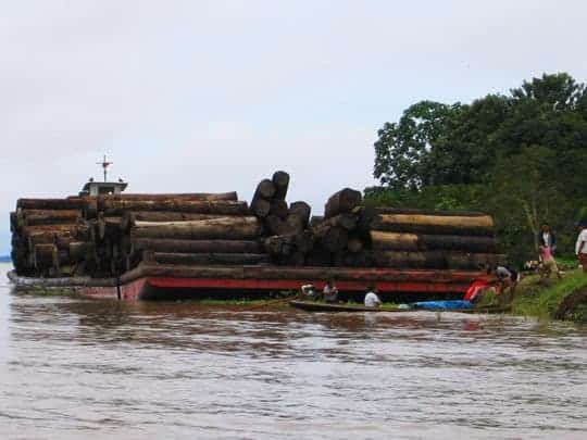 Huge Logging Boats Floating Down The Amazon in Colombia