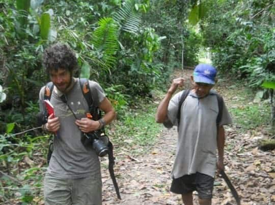 A Backpacker Walks With A Shaman Before His Ayahuasca Ceremony