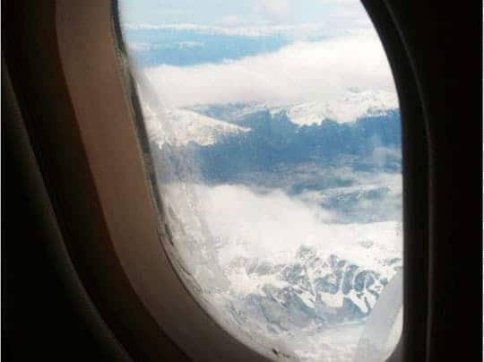 A Photo of Mountain Tops in the Andes Taken Through A Plane Window