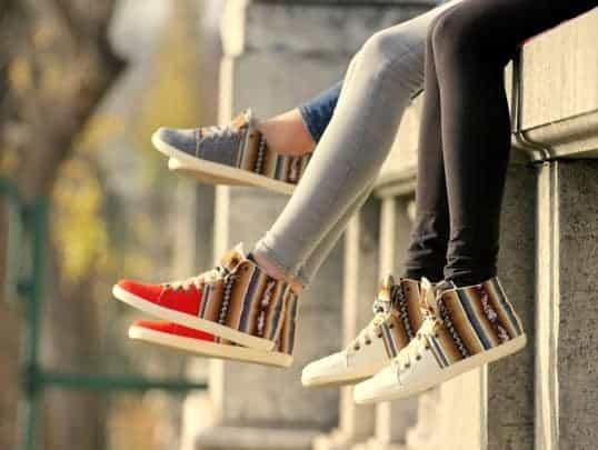 Three Pairs Of Girl's Legs Wearing Perus in Paris