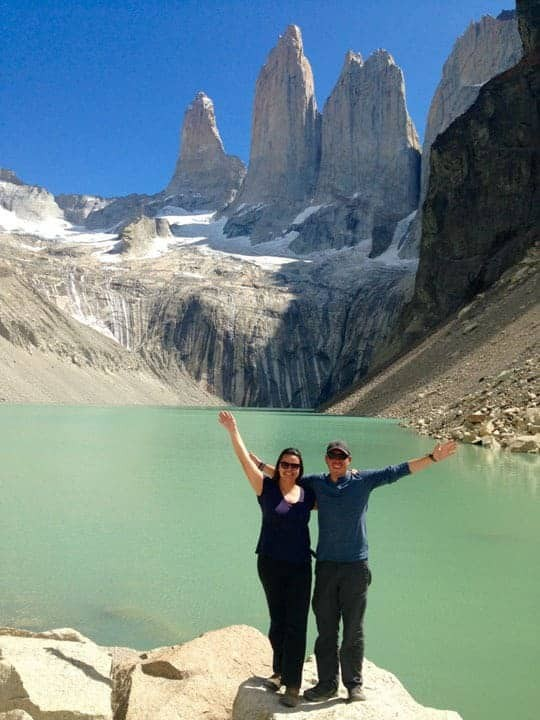 A Couple Pose In Front of a Turquoise Lagoon in Torres del Paine National Park