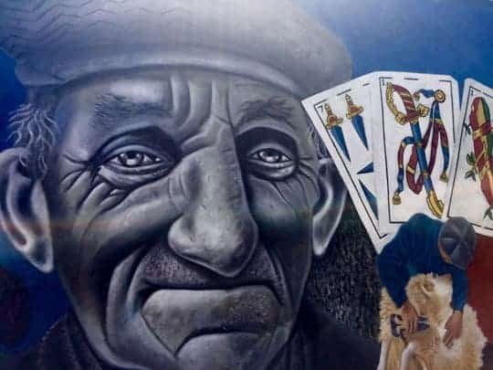 Graffiti of an Old Man's Face & Some Playing Cards in Puerto Natales, Chile