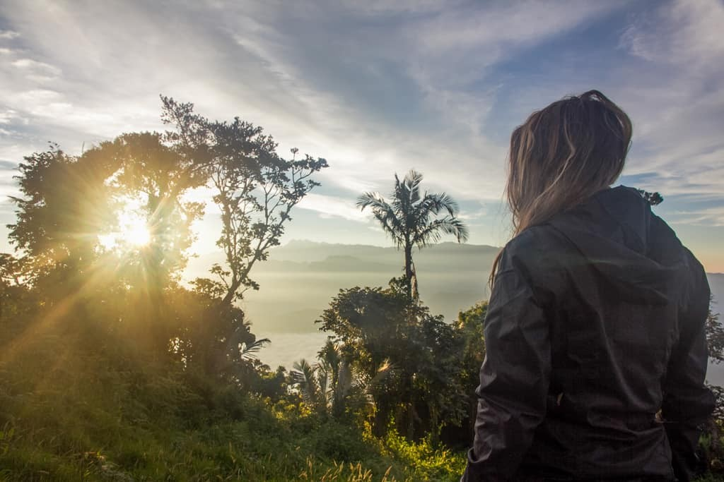 Girl looking at mountain scenery in Colombia.