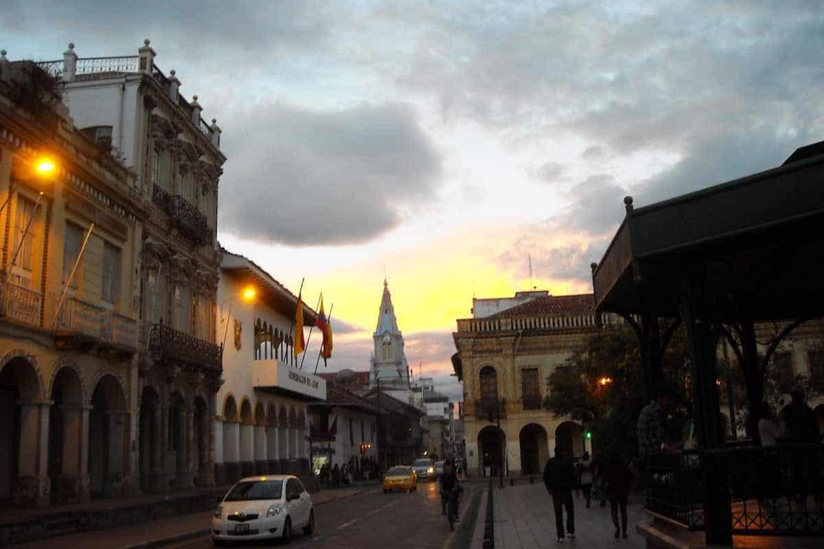 A view down a colonial street at dusk in Cuenca, Ecuador