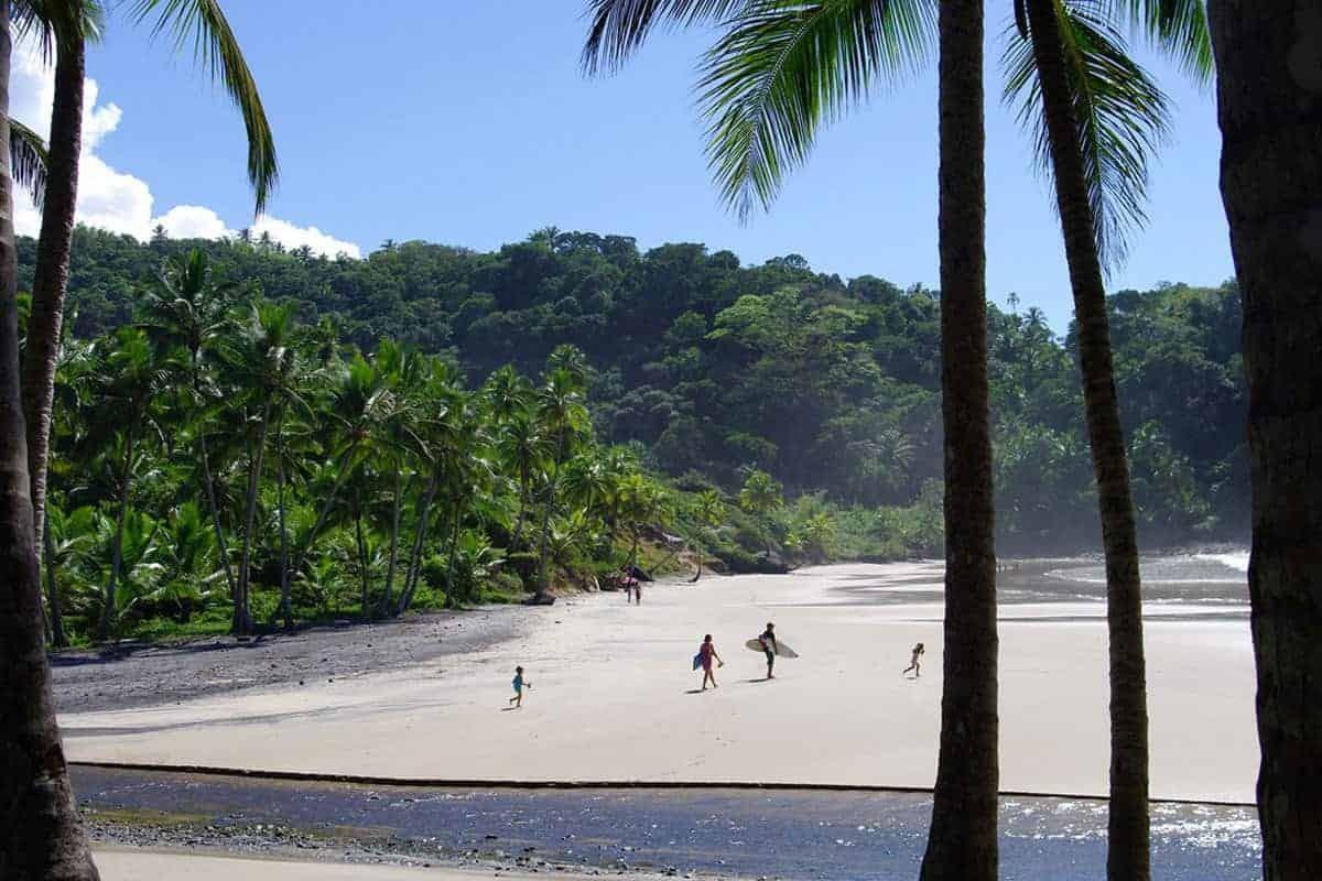 Surfers on the beach in Itacaré, Brazil.