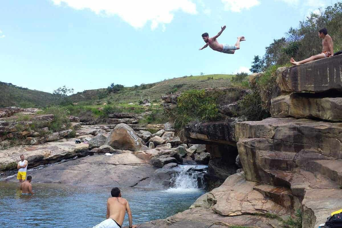 A man jumps of a rock into the water in San Gil, Colombia