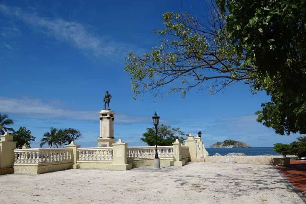 A statue and a very blue sky in Santa Marta, Colombia