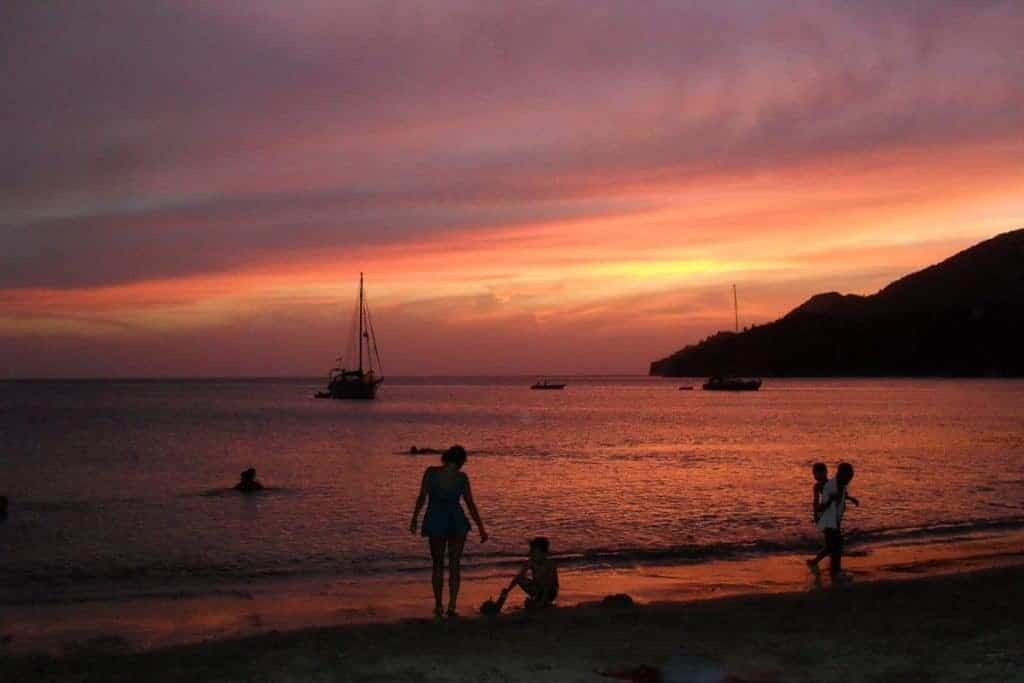Beach activity at sunset in Taganga