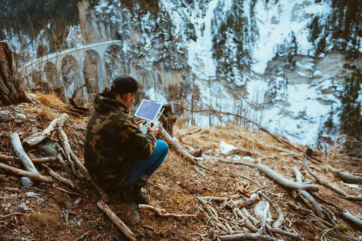 A Man Uses His Tablet In An Incredible Setting