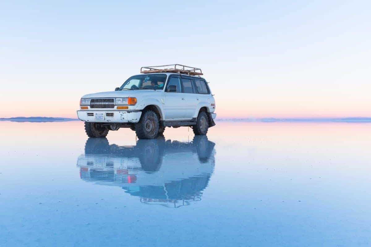 Jeep on the salt flats of Uyuni, Bolivia.