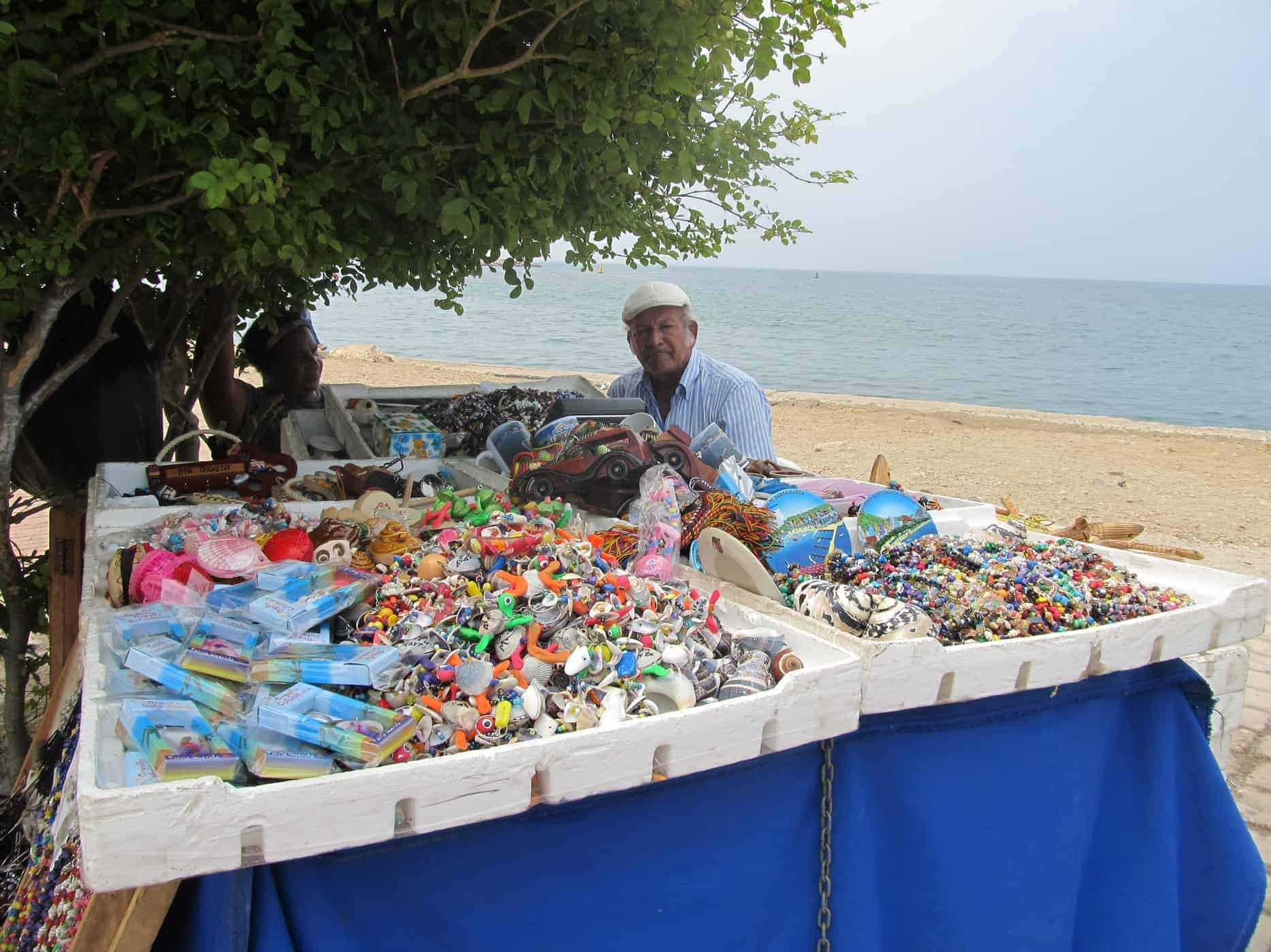 A local sells his wares on the beachfront in Santa Marta, Colombia.