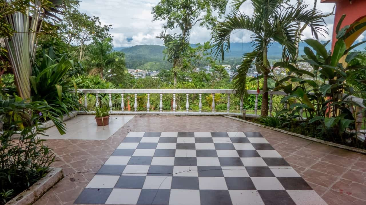 Life-sized chessboard floor of Hostal Tena Naui, Ecuador - complete with playing pieces!