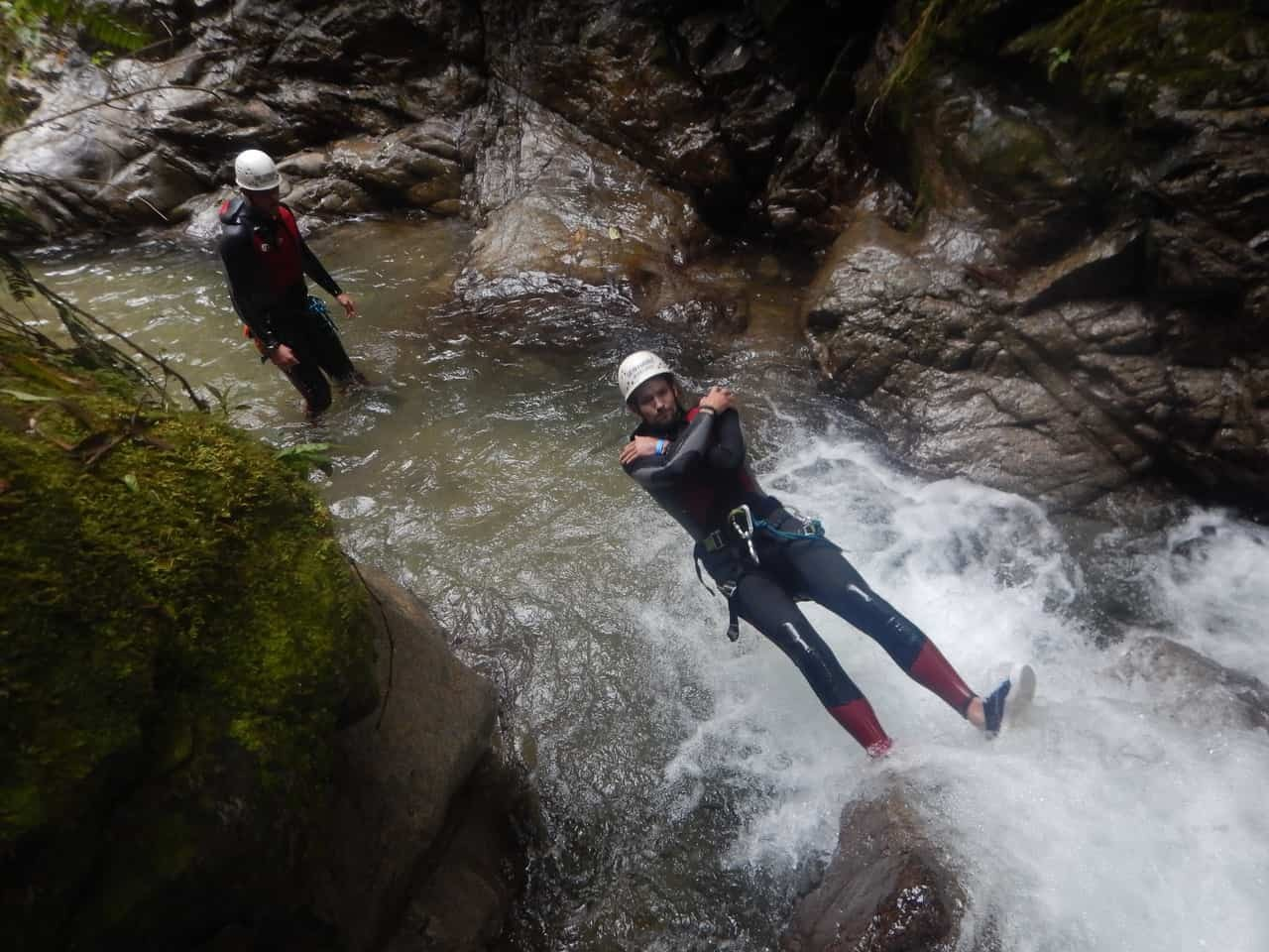 Splashing into the waters in the canyoning adventure with Takiri Travel, Ecuador