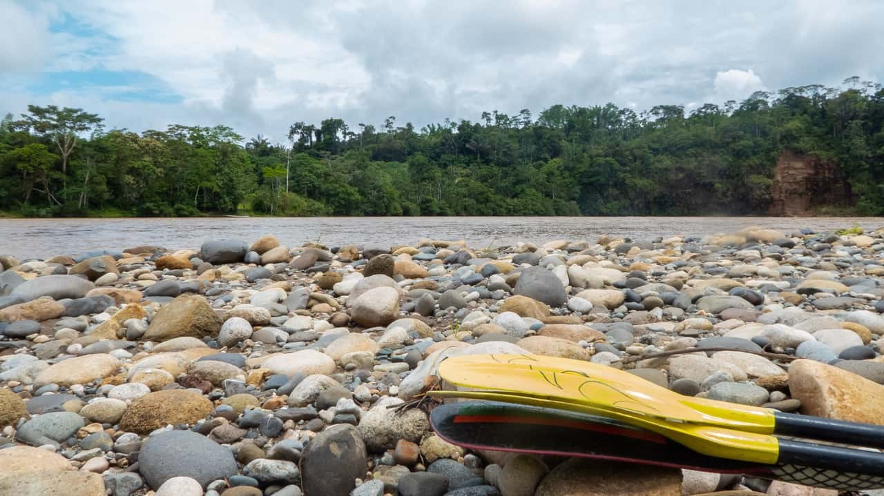 Kayak Oars Laying on the Pebbles By The River in Tena, Ecuador