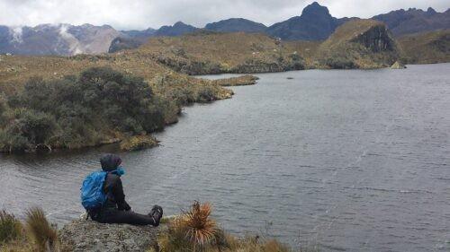A backpacker adoring the panoramic view of Cajas National Park Ecuador