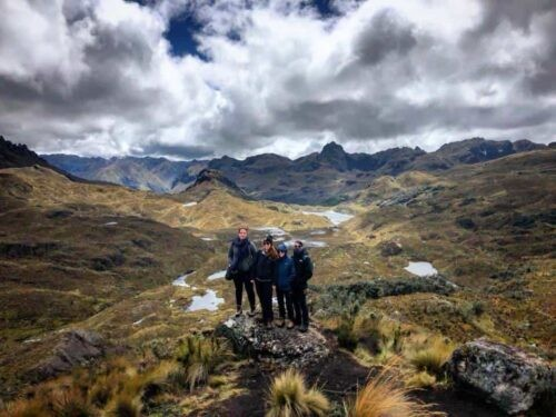 A group posing for a photo in the mountains of Cajas National Park Ecuador