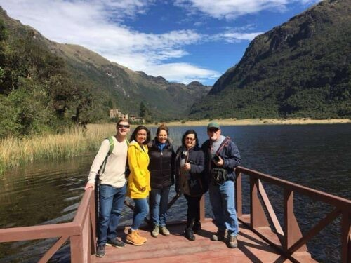 Backpackers posing by the river at Cajas National Park Ecuador
