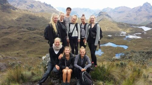 Backpackers smiling for a photo in the mountains Cajas National Park Ecuador