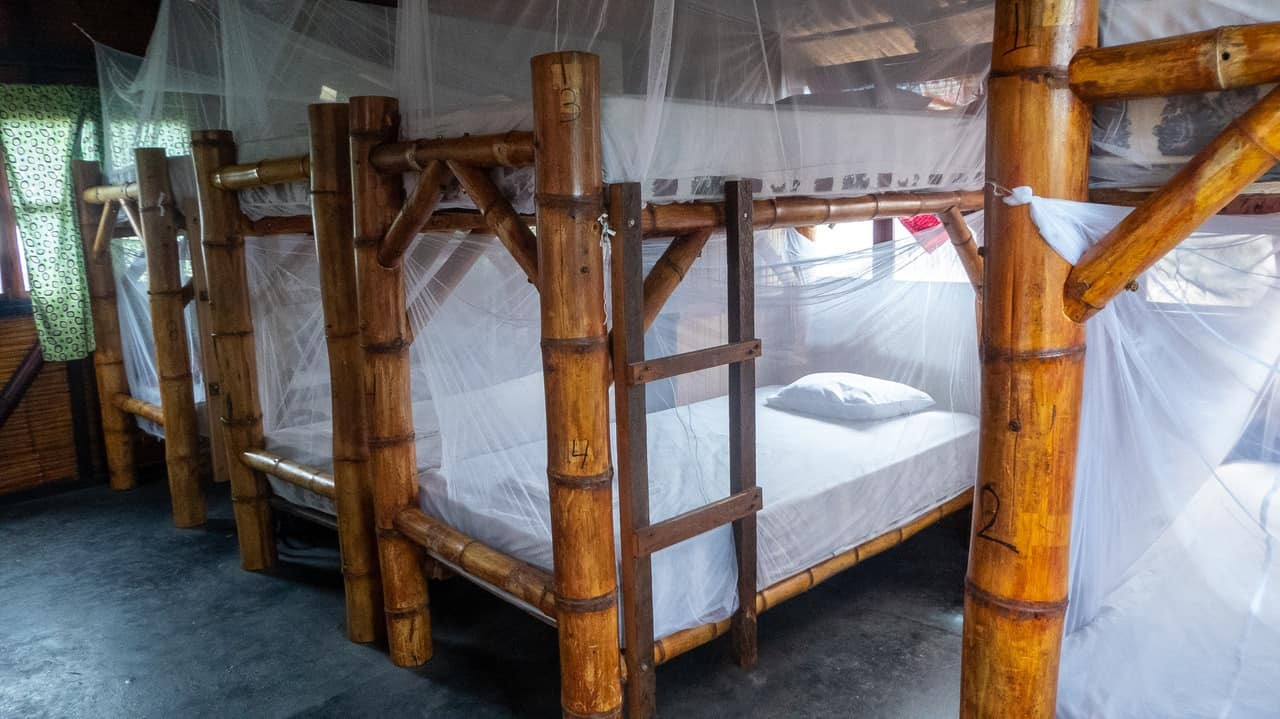 The bamboo bunk beds in the dorm room in Hidden House provide the perfect rustic ambience. Montañita, Ecuador.