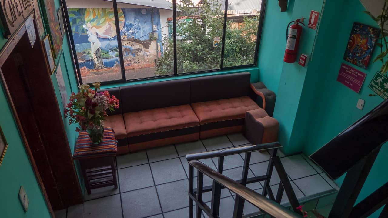 The landing of the stairs where ample art pieces are displayed - Erupcion hostel, Ecuador