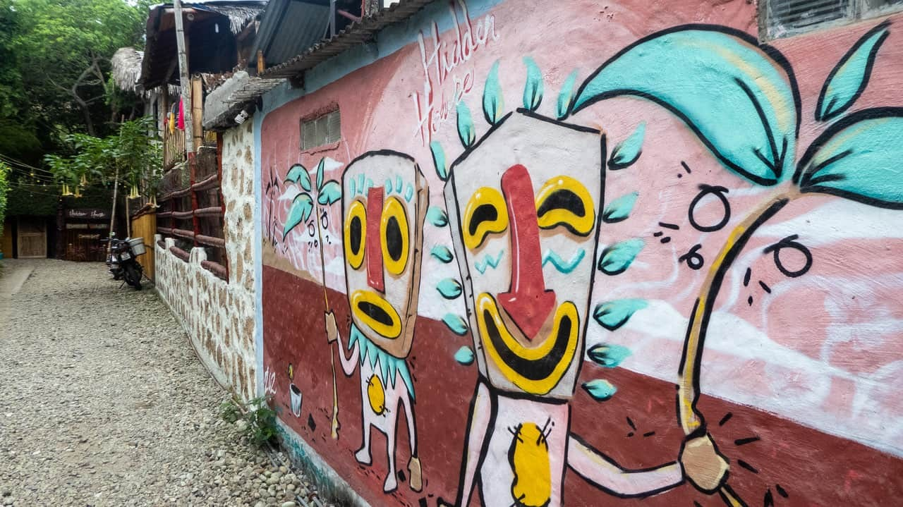 The vibrant graffiti displays the talent and whimsy of Ecuadorian artists in Hidden House Montañita Ecuador.