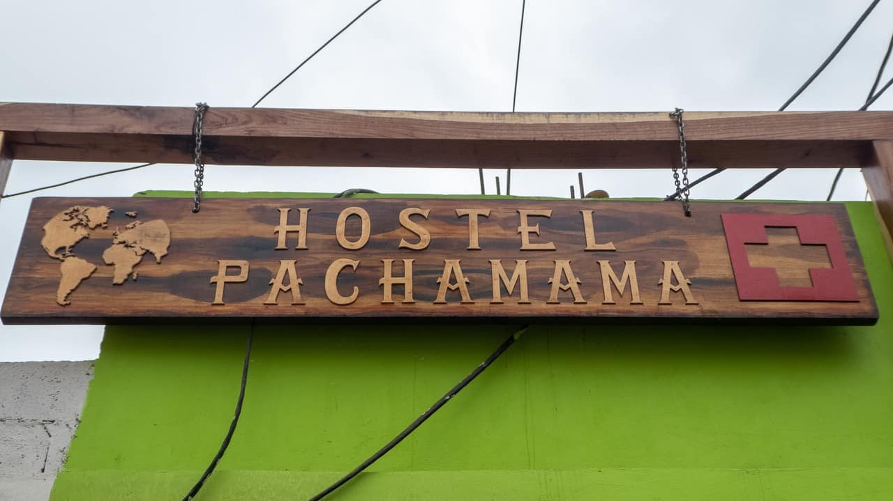 The sign above the door at Hostel Pachamama, Puerto Lopez