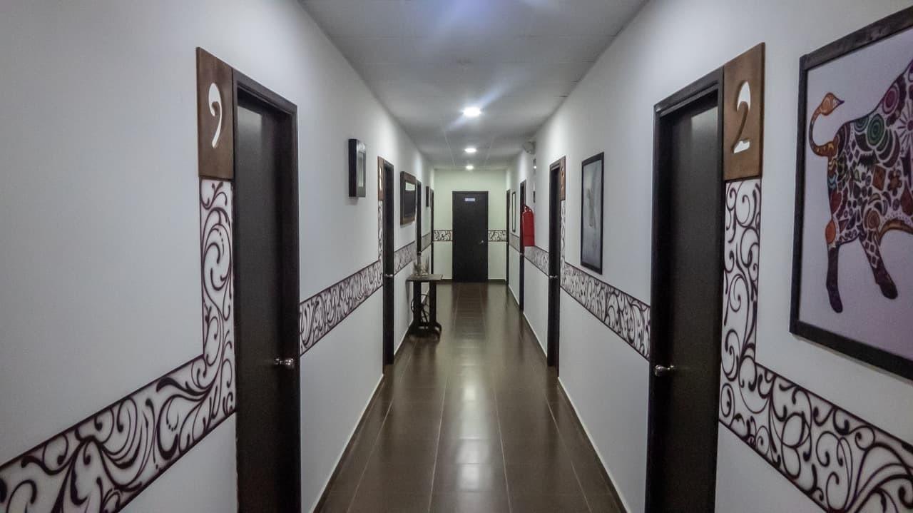 The elegant and clean hallway of Hotel Ancora, Ecuador.