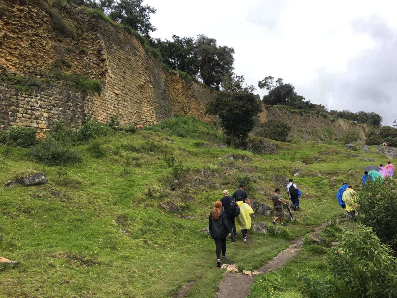 Visitors trekking the last few stretches to the entrance of the great ruins of Kuelap, Peru.
