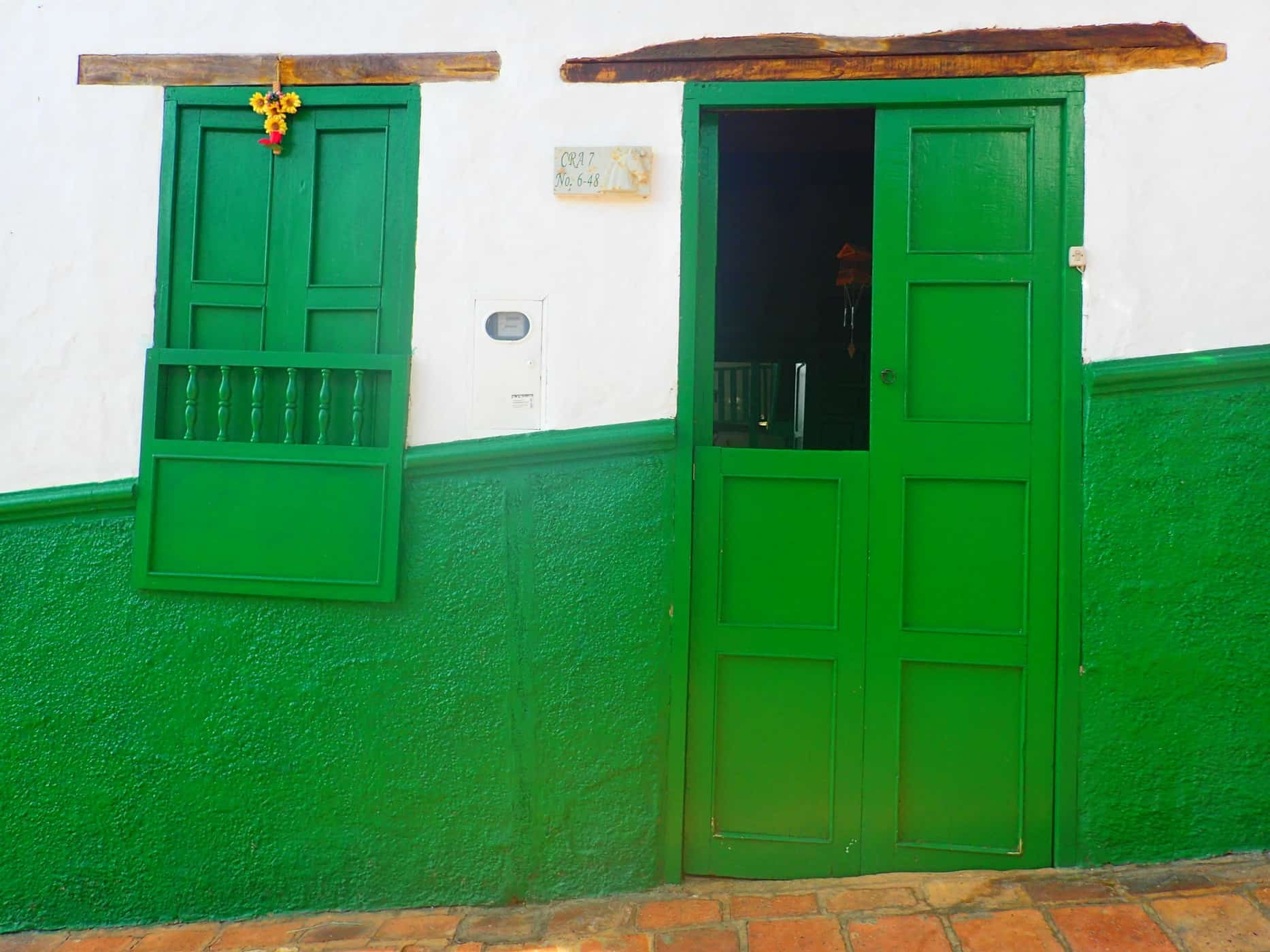 Bright green doors of Barichara, Colombia.