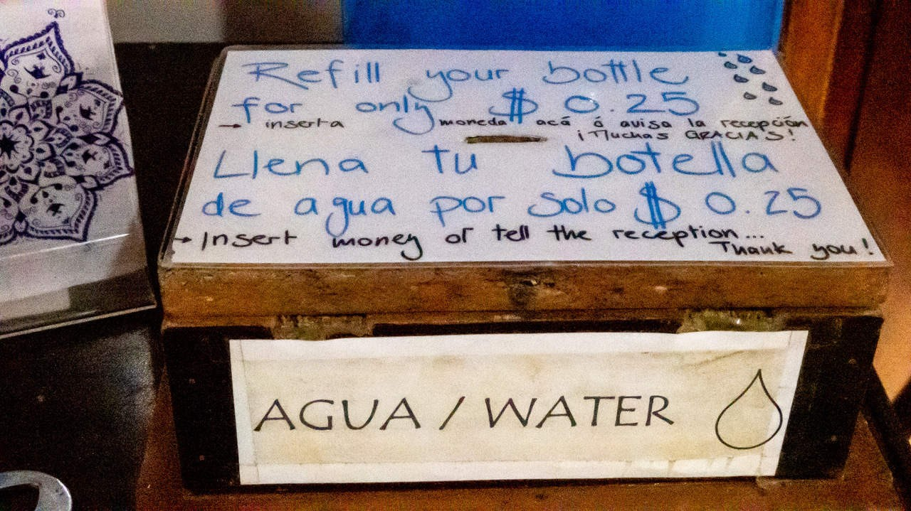 The guests of Esperanto Hostel can drop their coins in this box to refill their water bottle. Montañita, Ecuador.