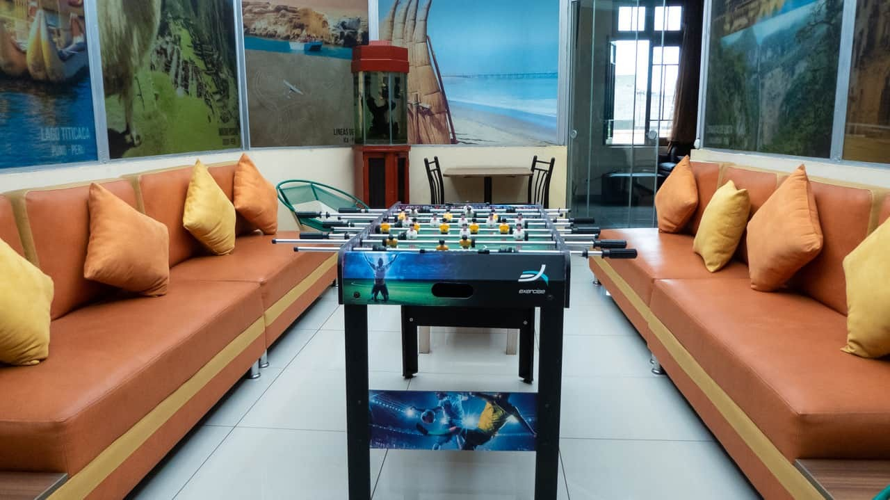 The Common Area With Sofas and Table Footbal, Lima House Hostel, Peru.