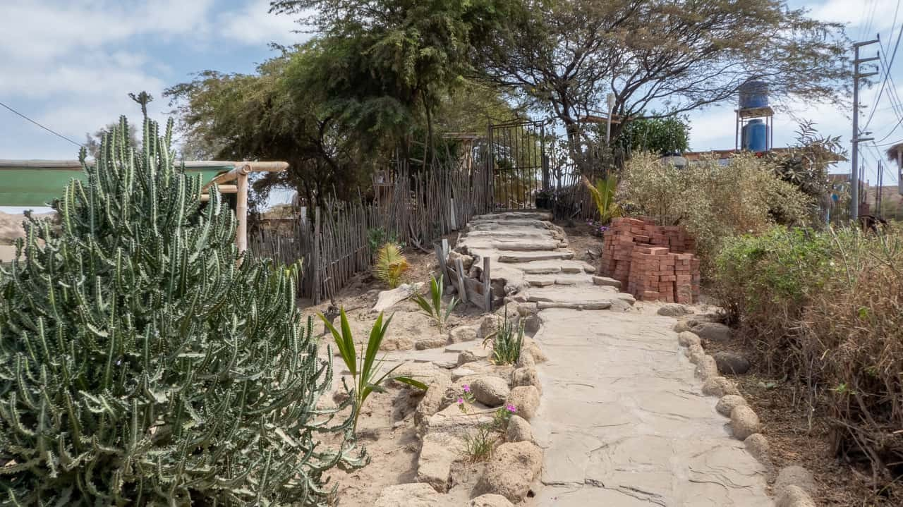 The simple sandy pavement leading to Geko Hostel, Mancora, Peru.