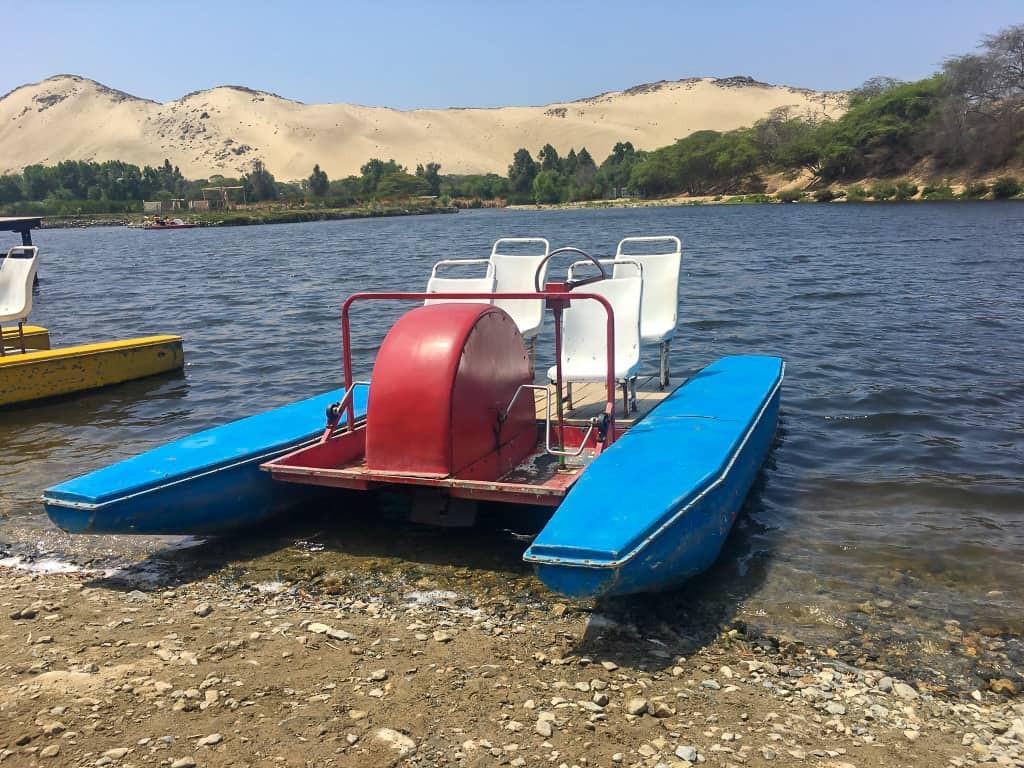 Paddleboating in Laguna de Conache is also part of the sandboarding tour in Trujillo, Peru.