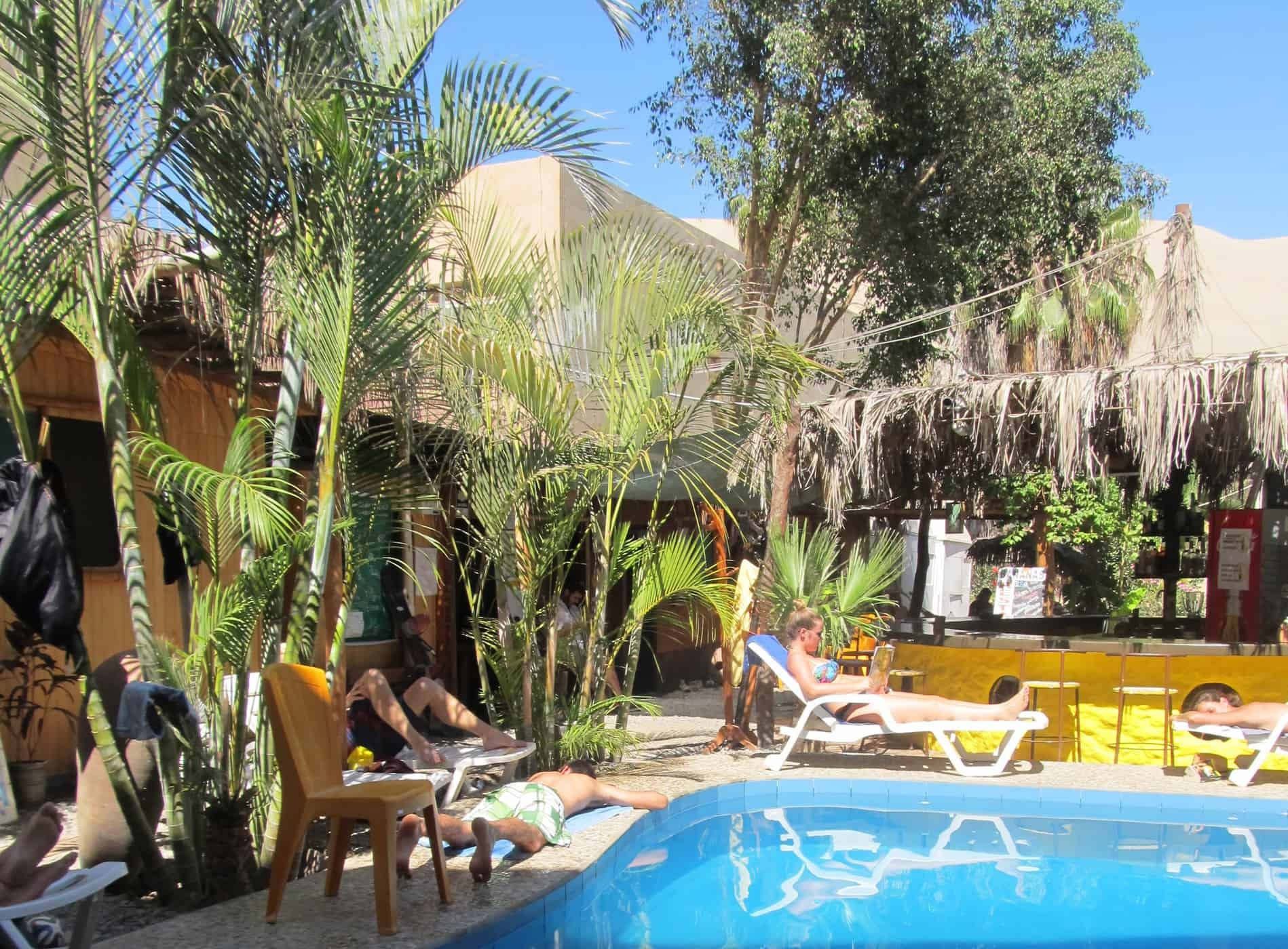 Relaxing by the pool at Bananas Hostel Huacachina