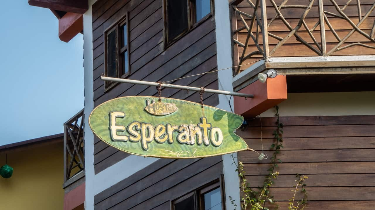 Artistically crafted signboard of Esperanto Hostel Montañita, Ecuador