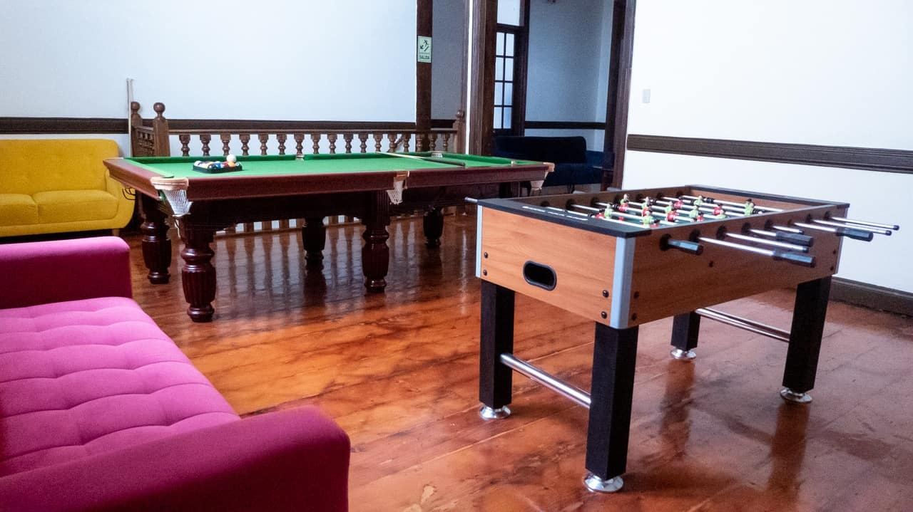 Pool table and table football table at Orchid Hostels, Lima.