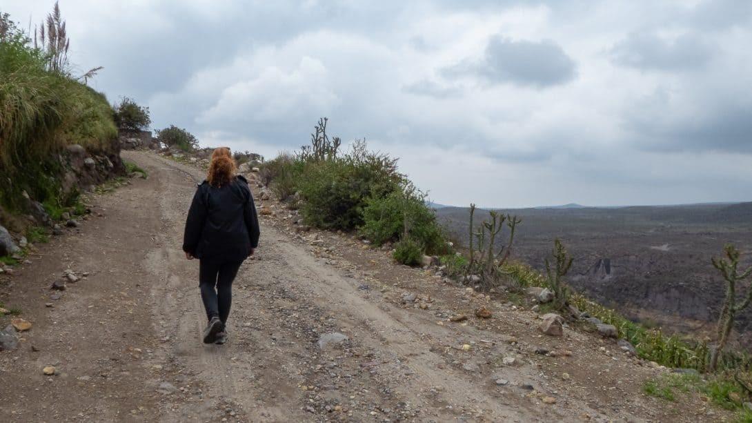 Girl trekking close to the Salina's Salt Lagoon.