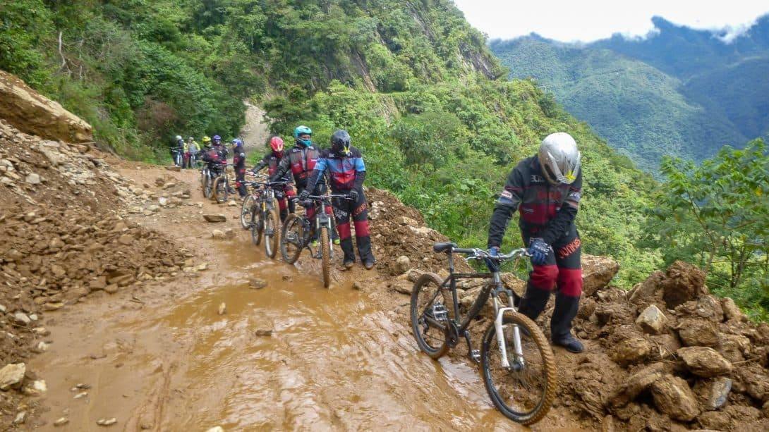 Cyclists passing a landslide on Death Road