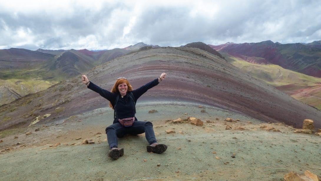 Girl sits on The Alternative Rainbow Mountain, Palccoyo, Near Cusco