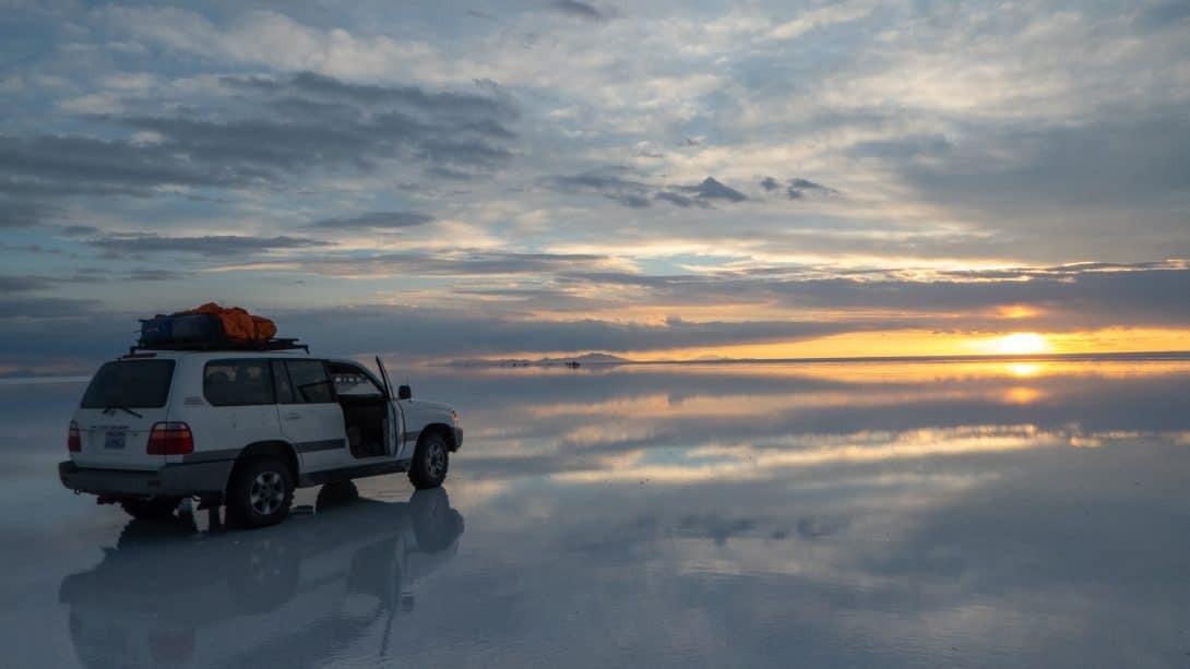 Car sits on Uyuni salt flats