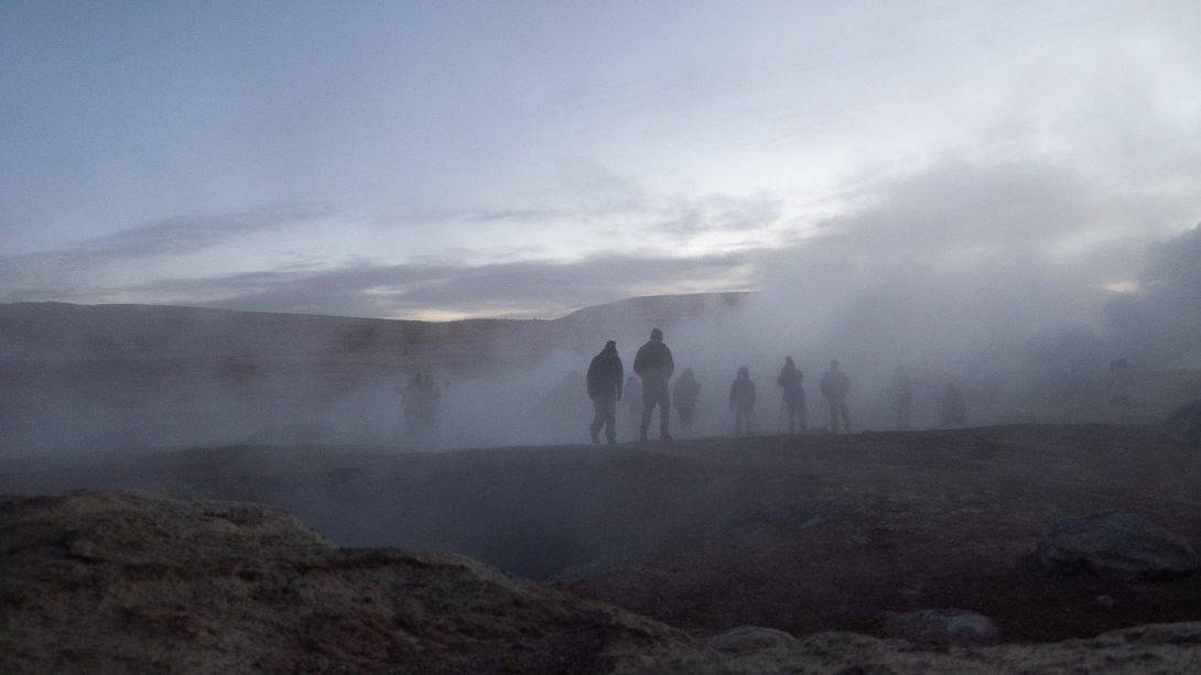 People surround geysers