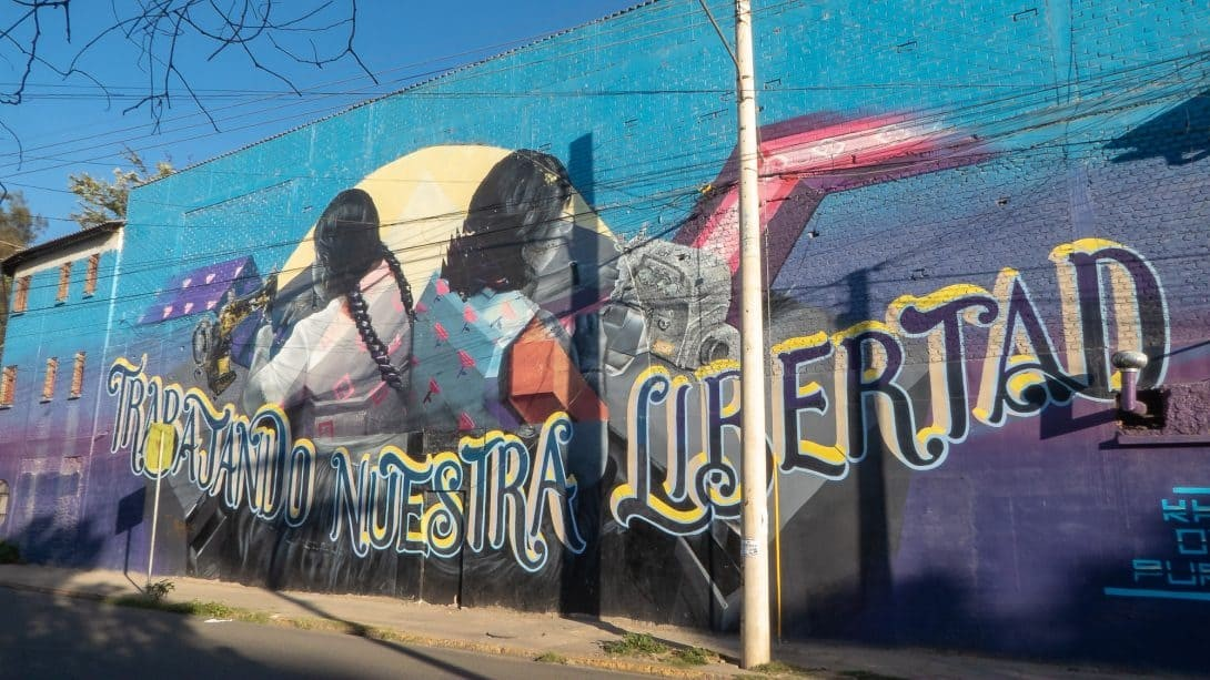 Prison wall mural in Cochabamba seen with Bike Art Tour